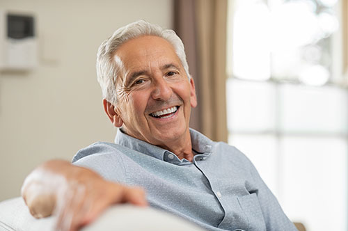 Woman smiling up at dentist